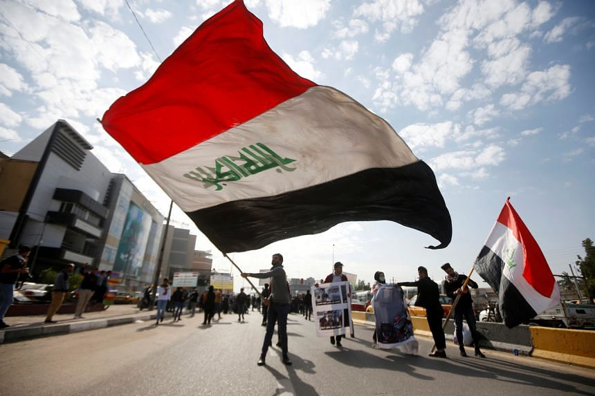 University students attend a protest against the US and Iran interventions, in Basra, Iraq, on Jan 8, 2020.