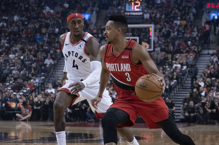 Portland Trail Blazers guard CJ McCollum (right) drives to the basket as Toronto Raptors forward Rondae Hollis-Jefferson defends in Canada on Jan 7, 2020.