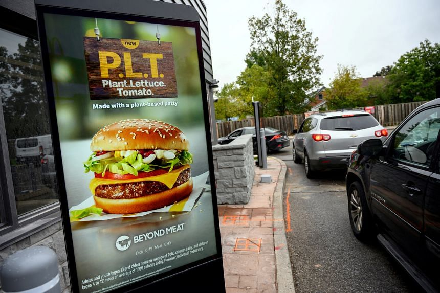 """A sign promoting McDonald's """"PLT"""" burger with a Beyond Meat plant-based patty in Canada on Oct 2, 2019."""