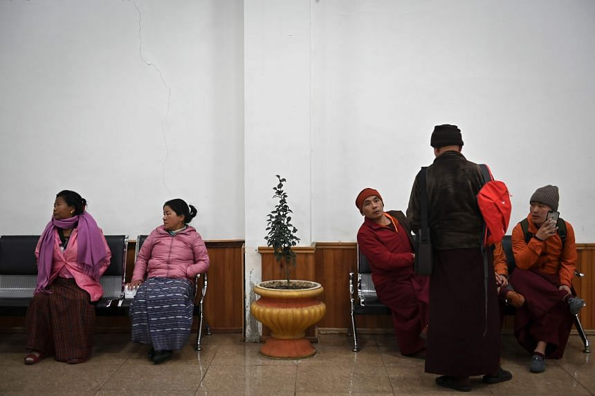 Women and Buddhist monks waiting to take a flight at the International Airport in Paro, Bhutan, on Dec 10, 2019.