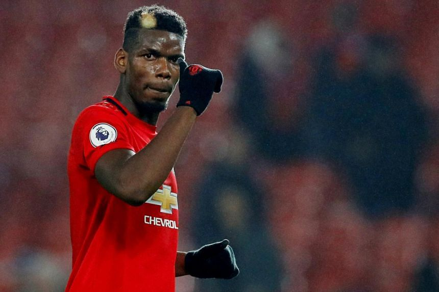 Manchester United's Paul Pogba acknowledges fans after a match, on Dec 26, 2019.