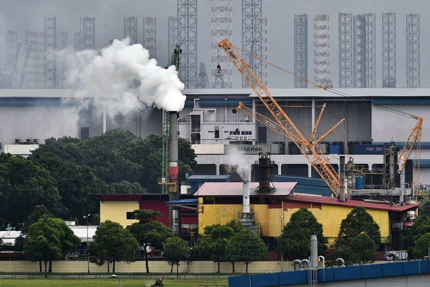 A factory emits fumes from its chimney in Tuas, on Dec 11, 2018.