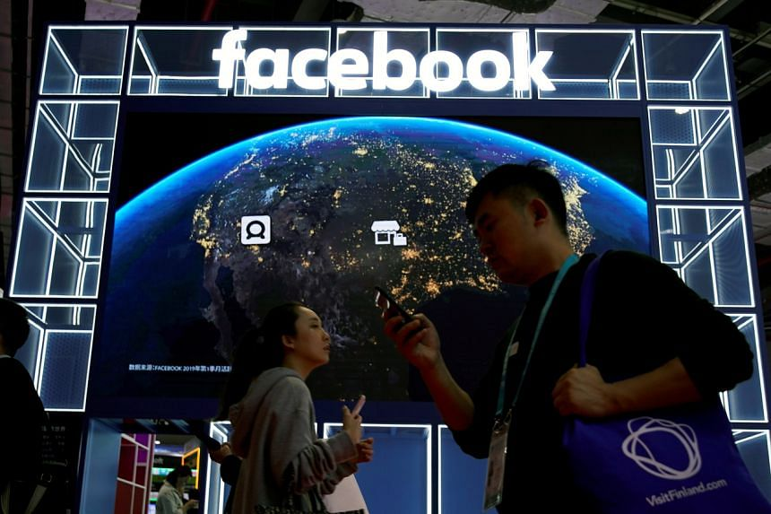 In a photo from Nov 6, 2019, a Facebook sign is seen at the second China International Import Expo in Shanghai, China.