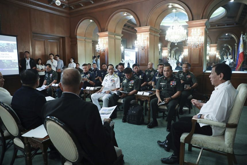 President Rodrigo Duterte (right) held an emergency meeting with his defence secretary and top military and police officials on Jan 5 to discuss the evacuation plans.