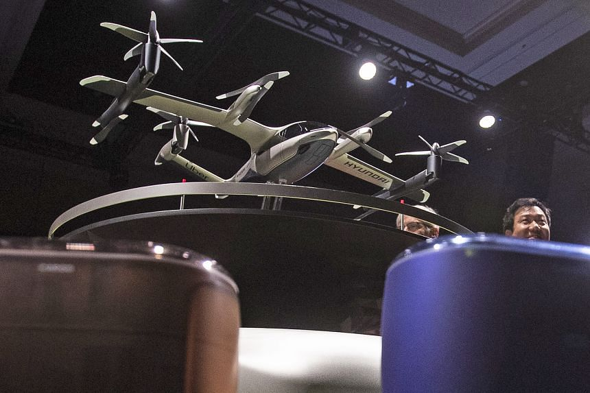 """An S-A1 model aircraft of the Hyundai and Uber Elevate urban air taxi concept being displayed at a press conference at the Consumer Electronics Show in Las Vegas on Monday. The aircraft utilises """"distributed electric propulsion"""", designed with multip"""