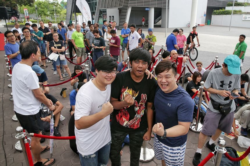 From left: ITE College Central students Joseph Wong and Amir Syariqul Haekal Amir Razif Shari, both 17, and well-being consultant Benjamin Ng, 34, standing in front of the queue as the first three registrants of the 2020 OCBC Cycle yesterday.