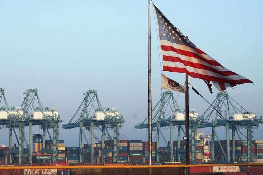An American flag flies at the Port of Los Angeles, the US' busiest container port, on Nov 7, 2019 in San Pedro, California.