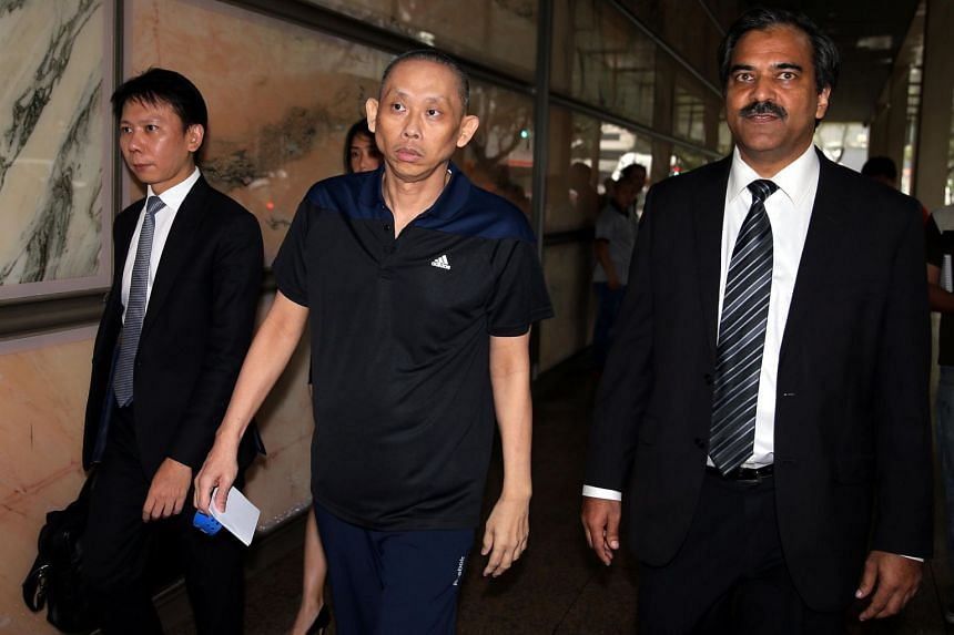 In a photo taken on Nov 25, 2015, Dan Tan Seet Eng (centre) is seen leaving the Supreme Court.