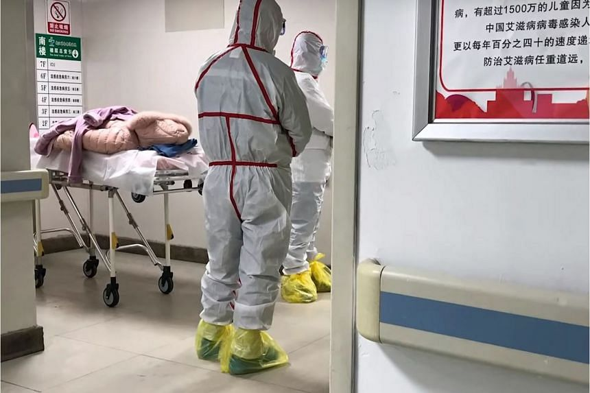 Medical staff in protective gear at the Wuhan Medical Treatment Centre.