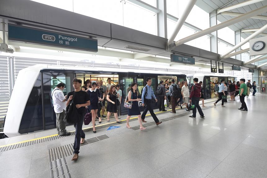 In this file picture, commuters are seen at Punggol LRT station on Dec 26, 2016.