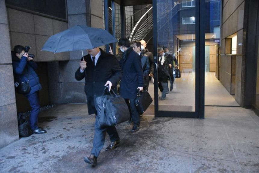 Officials of the Tokyo District Public Prosecutors Office leave the office of Japanese lawyer Junichiro Hironaka, a member of Carlos Ghosn's defence team, in Tokyo on Jan 8, 2020.