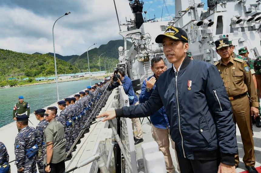 A handout photo taken and released on Jan 8, 2020 by the Presidential Palace shows Indonesian President Joko Widodo during his visit to a military base in the Natuna islands, which border the South China Sea.