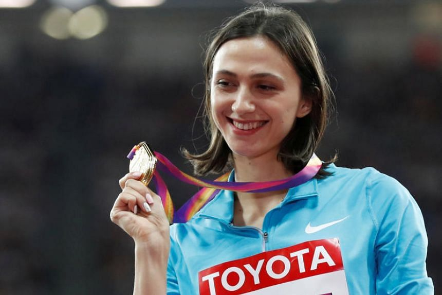 Russia's high-jump world champion Mariya Lasitskene urged fellow competitors to challenge the country's athletics body over its handling of its doping ban.