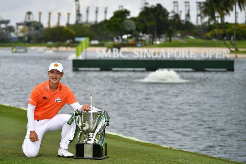In a photo from Jan 20, 2019, Thailand's Jazz Janewattananond poses with his trophy after the final round of the SMBC Singapore Open at the Sentosa Golf Club.