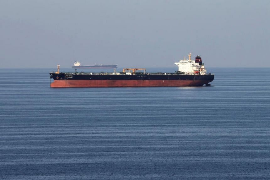 A file photo taken on Dec 21, 2018, of oil tankers passing through the Strait of Hormuz. The spike in charter rates shows how the escalating conflict between the US and Iran is spilling over into global oil supply chains.