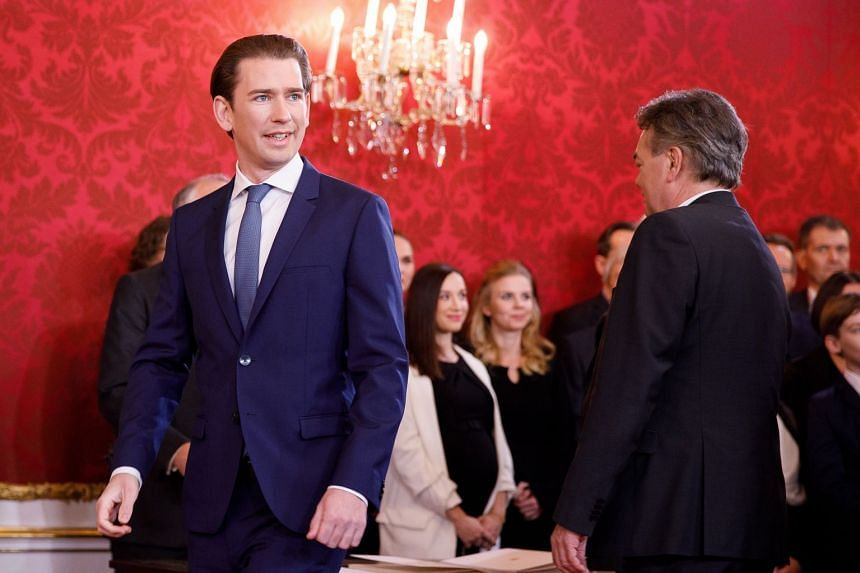Kurz (left) arrives for the swearing-in of the new coalition government on Jan 7, 2020.