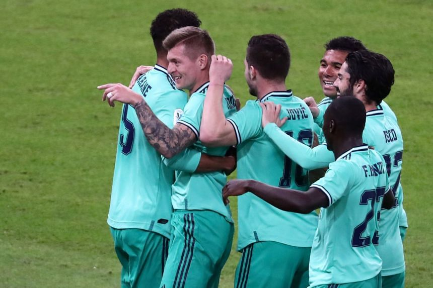 Real Madrid's Toni Kroos celebrates his goal with team mates.