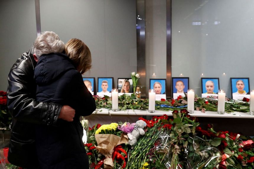Relatives of crew members aboard the Ukranian jet mourn at a memorial at Boryspil international airport outside Kiev.