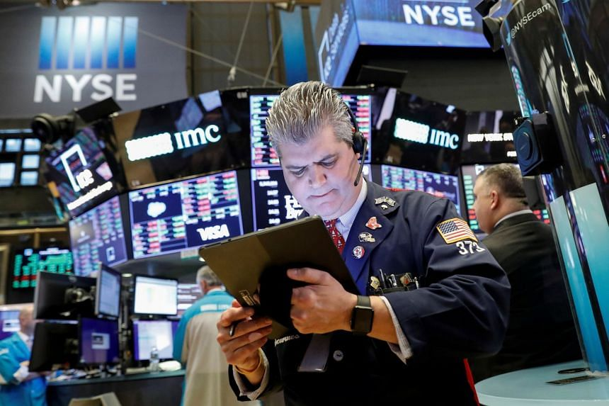 Traders work on the floor at the New York Stock Exchange, Jan 8, 2020.