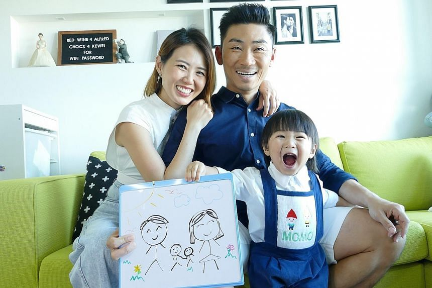 Married home-grown singers Tay Kewei and Alfred Sim and their two-year-old son MoMo.