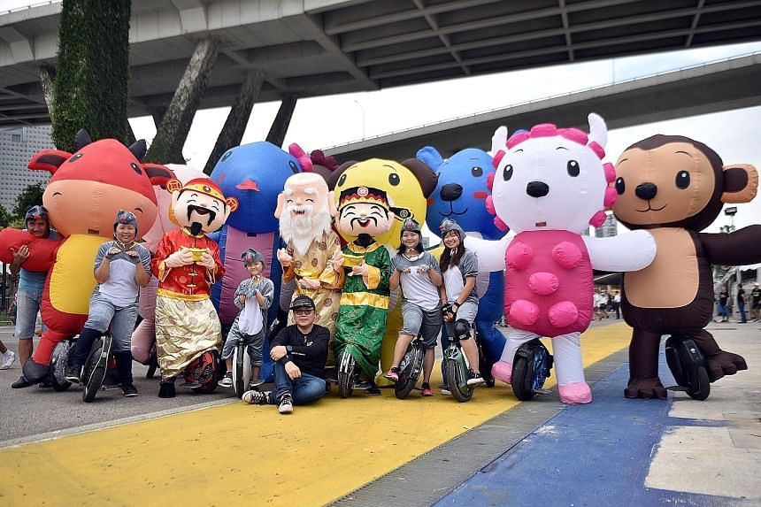 Members of the electric unicycle community, The Wheelies, decked out in some of the costumes they will be wearing at this year's Chingay parade. The 2m-tall inflatable costumes include the 12 animals of the Chinese horoscope and four deities - God of