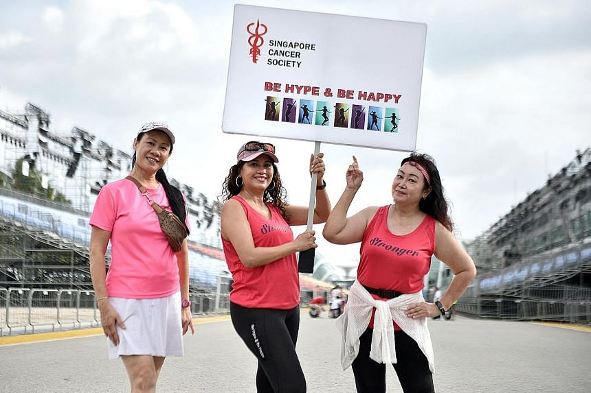 Ms Ramlah De Rose flanked by two members of Be Hype & Be Happy, Ms Kelly Ang (left) and Ms Joanna Tan, at last Saturday's rehearsal. The group comprises 27 cancer patients and survivors aged between 47 and 72.