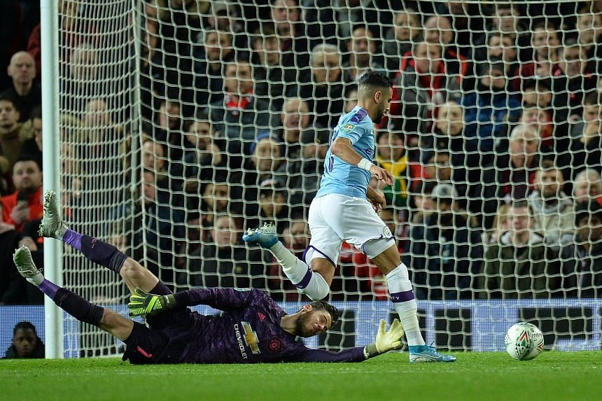 Manchester City's Riyad Mahrez beating Man United goalkeeper David de Gea to score his sixth goal in 19 starts in all competitions this season during the first leg of their League Cup semi-final clash on Tuesday. City won 3-1. PHOTO: EPA-EFE