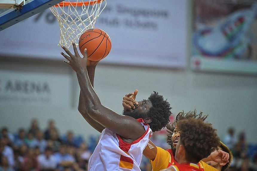 Slingers centre Anthony McClain attempting to score in the face of suffocating defence by the Saigon Heat. He finished with 11 points, 13 rebounds and five blocks but the Heat's Christien Charles won the battle of the big men with 25 points and 13 re
