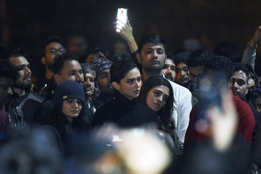 Bollywood A-lister Deepika Padukone (centre) standing behind students chanting anti-government slogans at Jawaharlal Nehru University. They were protesting against a recent attack by masked men at the university which injured some 30 people.