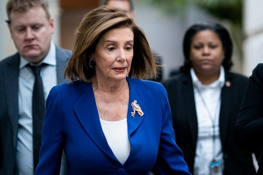 House Speaker Nancy Pelosi walks to a closed Democratic caucus meeting on Capitol Hill in Washington.