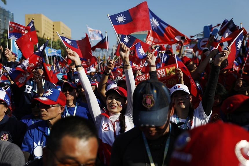 Supporters of Taiwan Kuomintang Presidential candidate Han Kuo-yu wave flags during a campaign event in Taiwan on Jan 9, 2020.