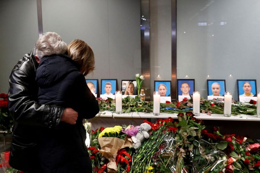 Relatives of the flight crew members of the Ukraine International Airlines plane that crashed in Iran mourn at a memorial at the Boryspil International airport outside Kiev, Ukraine, on Jan 8, 2020.