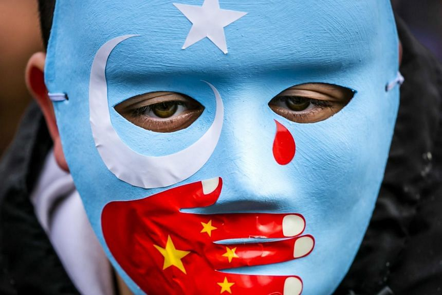 A demonstrator joins members of the Uighur community and sympathisers at a protest on the Dam square in the Netherlands on Dec 29, 2019.