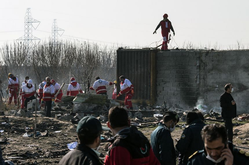 Rescue teams working at the scene where a Ukrainian airliner crashed shortly after take-off near Imam Khomeini airport in Teheran, Iran, on Jan 8, 2020.