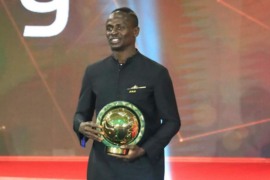 Senegal winger Sadio Mane smiles after winning his Player of the Year award.