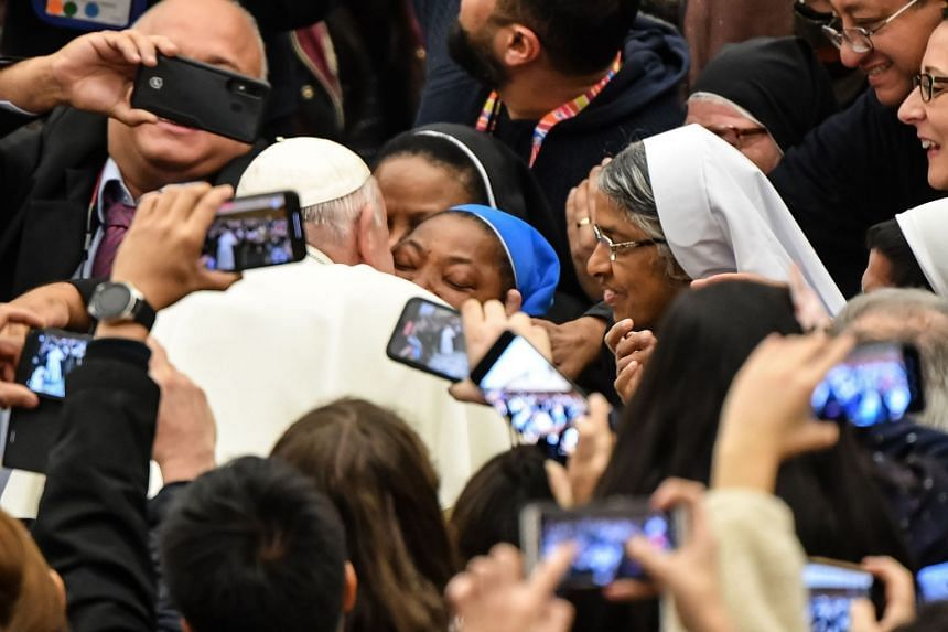 """Pope Francis kisses a nun who had been shouting """"Long live the pope!"""""""