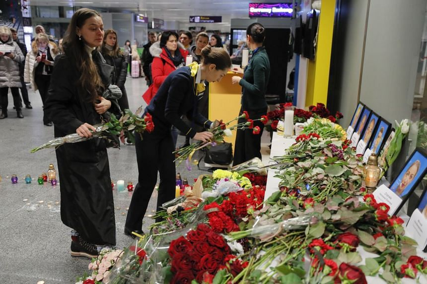 Relatives, colleagues, and friends of crew members of the Ukraine International Airlines Flight PS752 which crashed near Teheran lay flowers and light candles at Boryspil International Airport in Kiev, on Jan 8, 2020.