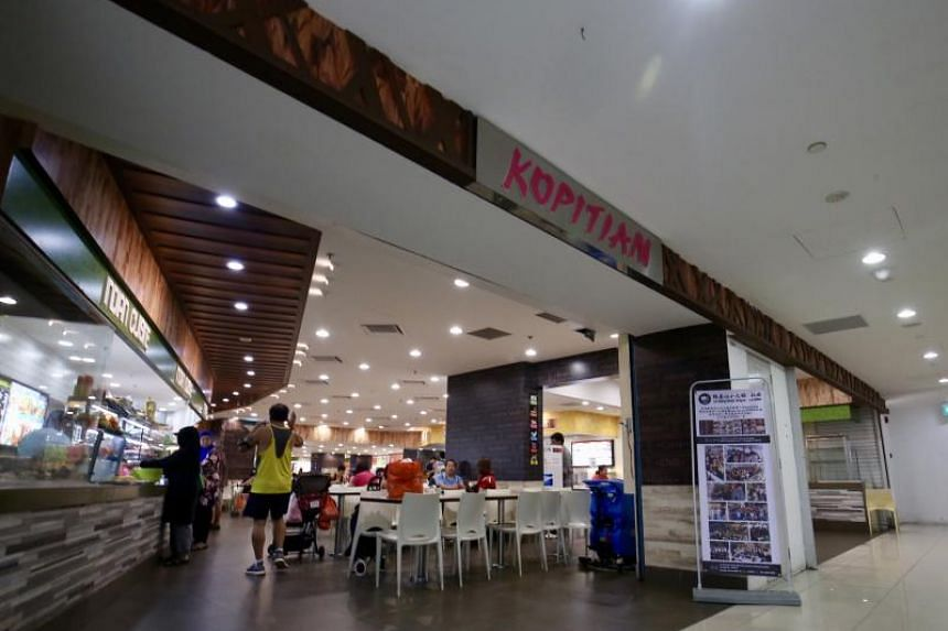 A manager of the Kopitiam outlet at Rivervale Plaza (above) is allegedly a co-conspirator in the robbery ruse.