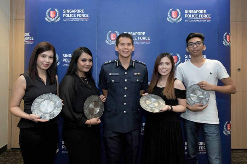 Assistant Police Commissioner Gregory Tan with Public-Spiritedness Award recipients (from left) Cecille Carrillo, Zunika Jamari, Berry Diow and Izwan Isnawan.