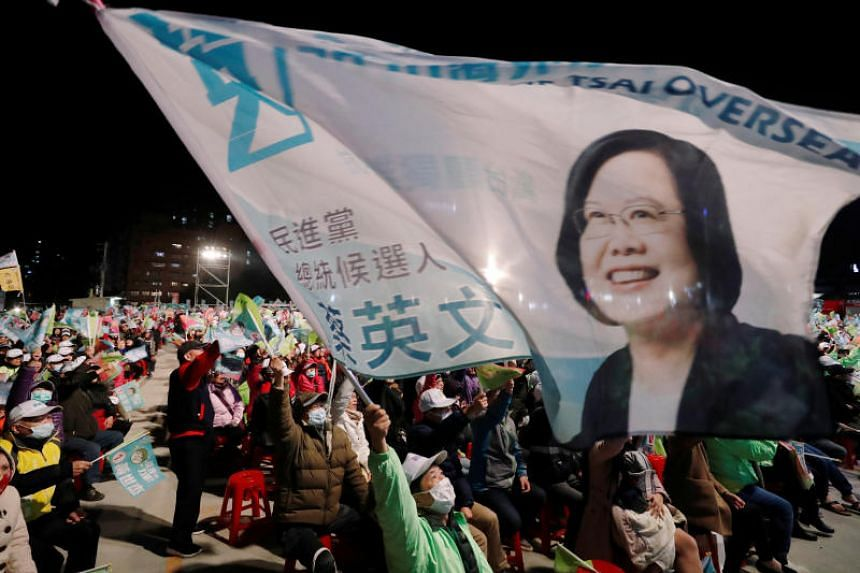 Supporters of Taiwan's President Tsai Ing-wen attend a campaign rally ahead of the presidential election in Taoyuan, Taiwan, on Jan 8, 2020.