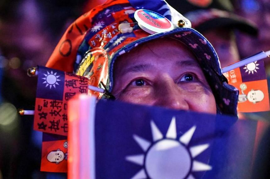 A supporter displaying the Taiwan flag during a campaign rally by Kuomintang presidential candidate Han Kuo-yu in front of the Presidential Palace in Taipei on Jan 9, 2020.