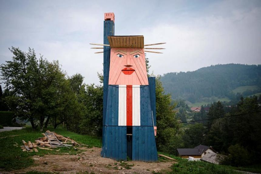 In this picture taken on Aug 29, 2019, a wooden statue of US President Donald Trump is seen in the village of Sela pri Kamniku, Slovenia.