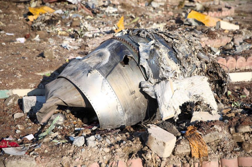 Debris on the ground after a Ukraine International Airlines plane crashed in Teheran. The NTSB cannot work in Iran due to US sanctions on the country, and will have to get special permission from the US Treasury to assist in any probe there.