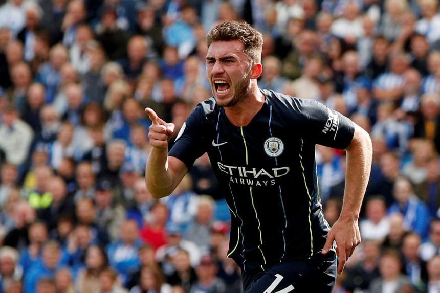 City's Aymeric Laporte celebrates a Premier League goal against Brighton.