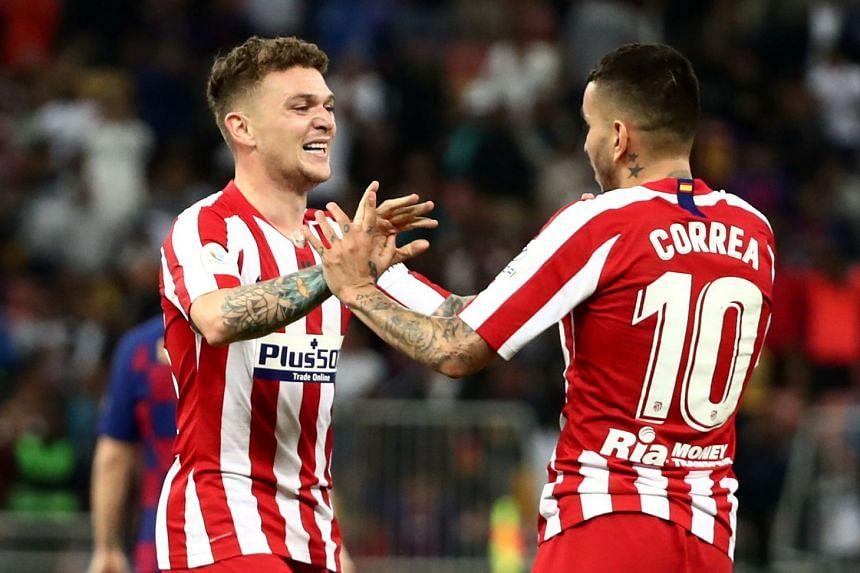 Atletico Madrid's Kieran Trippier celebrates with Angel Correa after the match.