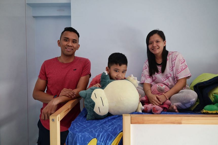 Mr Saiful Nor Mirza Abdul Samat, with his seven-year-old son Saiful Iman Saiful Nor Mirza, a Henry Park Primary 1 pupil, and wife Bernice Ng at their home, on Jan 9, 2020.