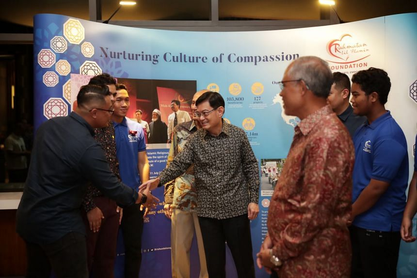 Deputy Prime Minister Heng Swee Keat, together with Minister-in-charge of Muslim Affairs Masagos Zulkifli, mingling with Rahmatan Lil Alamin Foundation volunteers and project leaders during the charity's 10th anniversary dinner at Park Royal on Beach