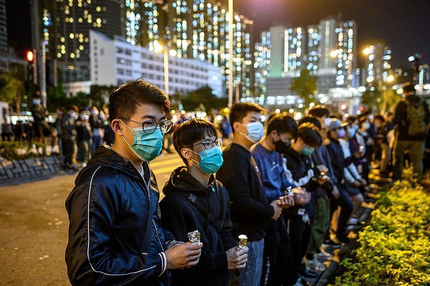 Mourners at a memorial service for Mr Alex Chow, 22 - who died two months ago from head injuries sustained after a fall inside a multi-storey carpark during clashes between the police and protesters - at Tseung Kwan O district of Hong Kong on Wednesd