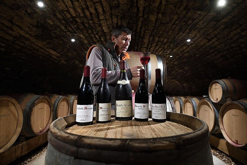 A French wine grower in his cellar. The US is threatening to impose tariffs of up to 100 per cent on $3.3 billion of French goods, including sparkling wine, in retaliation for a digital services tax that it says penalises American tech companies such