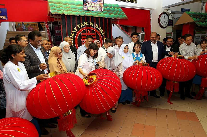 Deputy Prime Minister Wan Azizah Wan Ismail and Deputy Education Minister Teo Nie Ching (both centre) were among ministers who turned up yesterday at SMK Pusat Bandar Puchong 1 in Selangor to help put up lanterns for Chinese New Year. The school had
